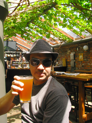 Bill enjoying a West Coast Pale Ale under the hop vines at Hop Garden, Wgtn